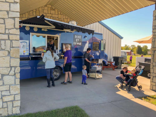 Guests enjoying the food trucks at the festival.