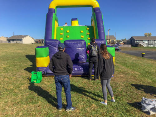 Even adults lined up to take on the Obstacle course, including Farmers State Bank President, James Moore.